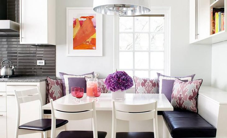 Beautiful Breakfast Nook With Fresh Flowers And Ample Lighting