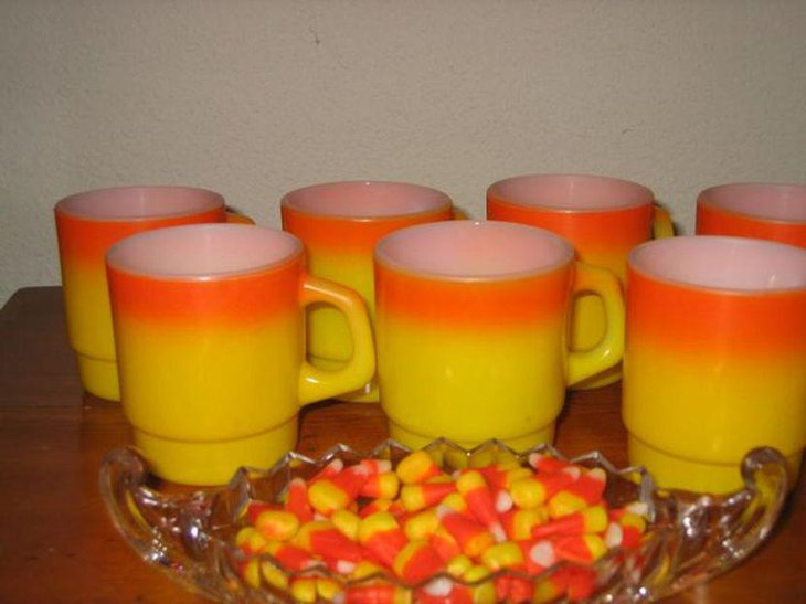 Beautiful candy corn coloured mugs for kids Halloween table decor
