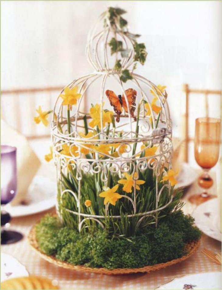 Beautiful DIY birdcage centerpiece with butterfly and flowers