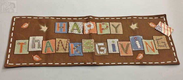 Beautiful Fall Colors and Happy Thanksgiving Spelled in Multi Color Table Runner