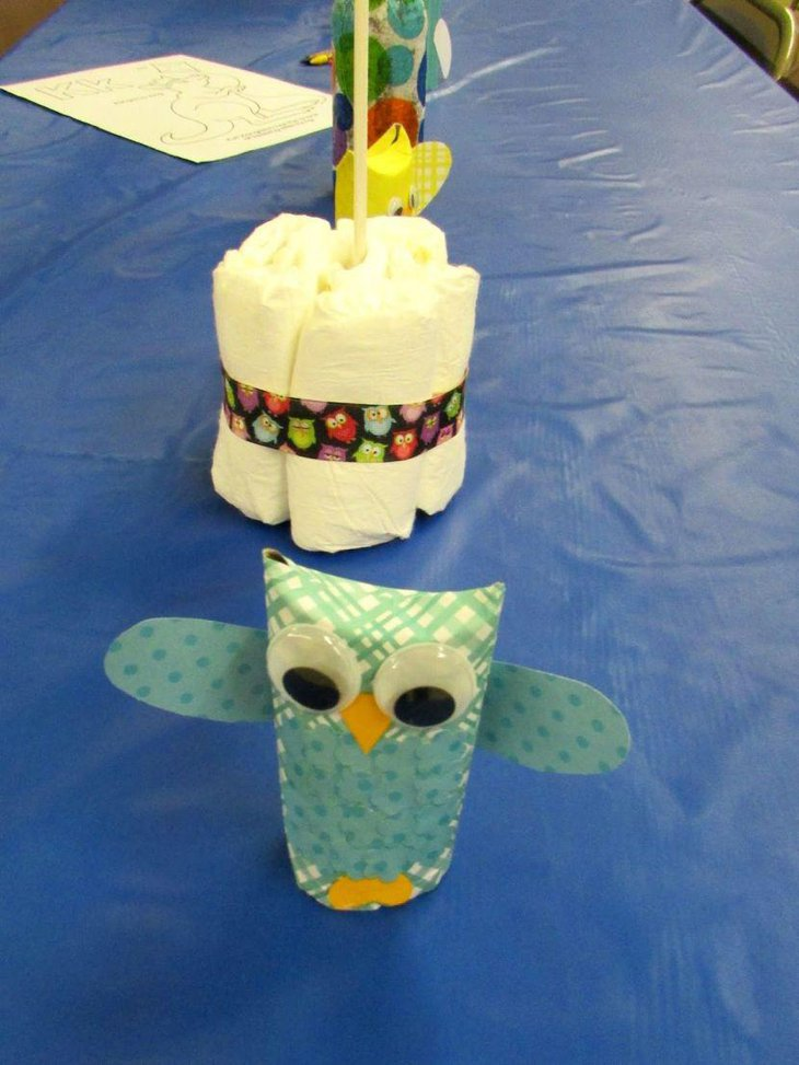 Beautiful owl centerpiece on a baby shower table