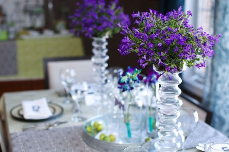 Beautiful purple floral decor on adult birthday party table