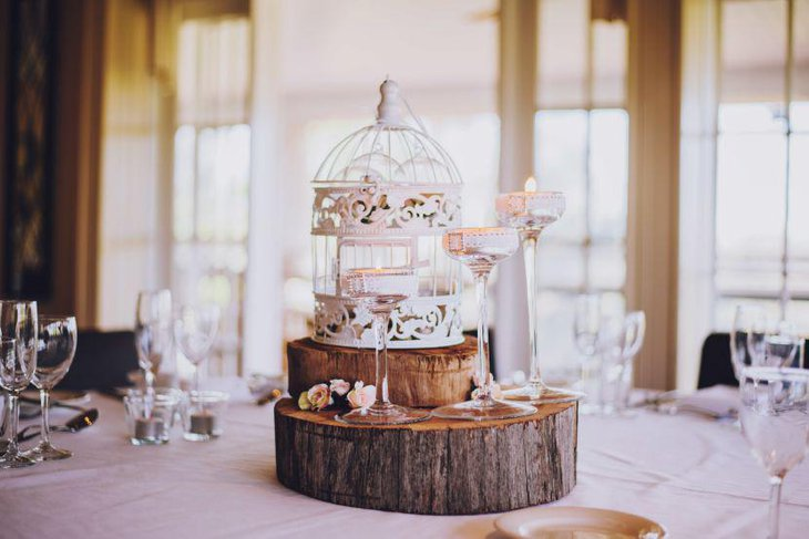 Beautiful Rustic Birdcage With Wooden Slices As Wedding Table Centerpiece