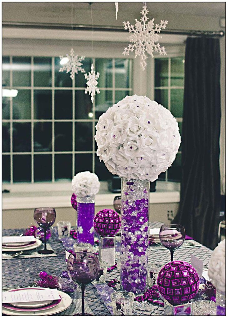 Beautiful winter wedding table decor with purple decorations