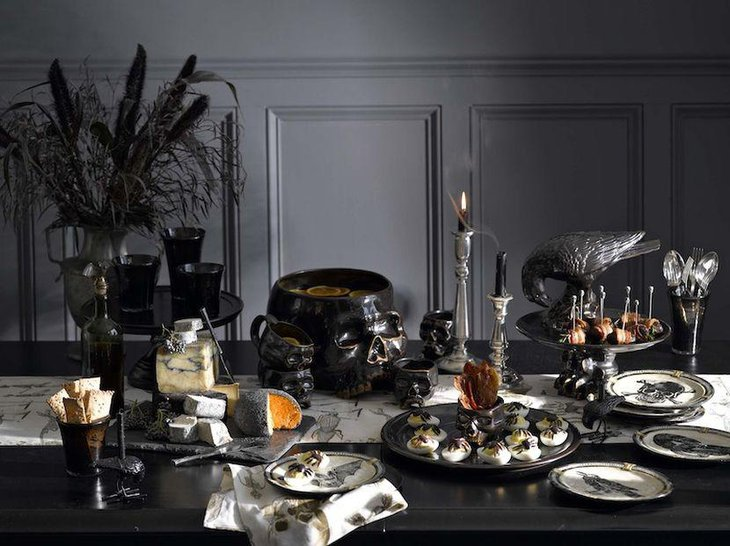Bewitching Halloween dessert table decor with black eerie decorative accessories