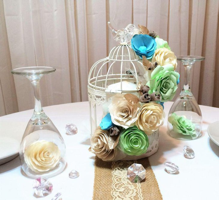 Birdcage centerpiece with paper flowers and candle