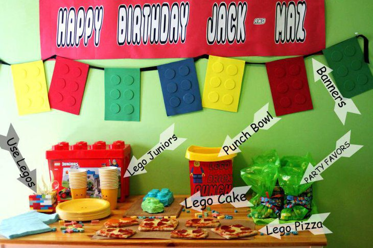 Birthday table decorations with Lego punch bowl Lego cake and Lego cups