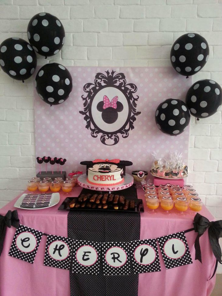 Black and pink themed Minnie Mouse candy buffet table decor