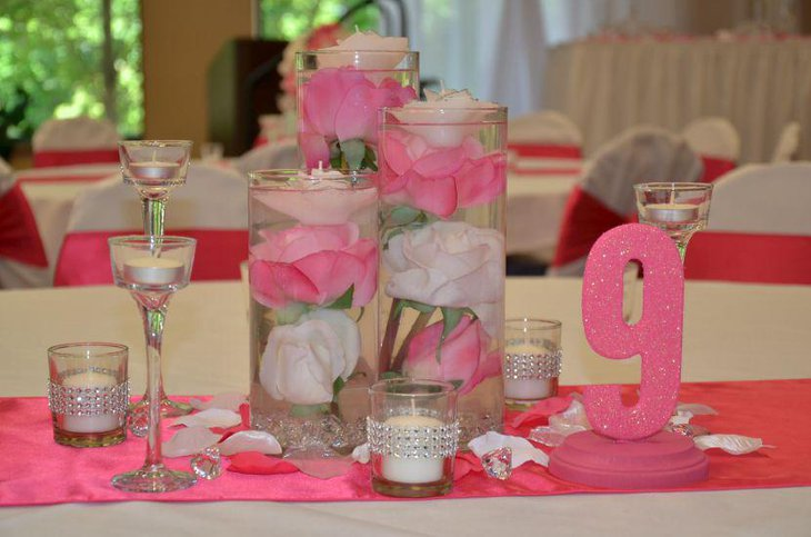 Bling candle centerpieces for wedding table in pink and white accents