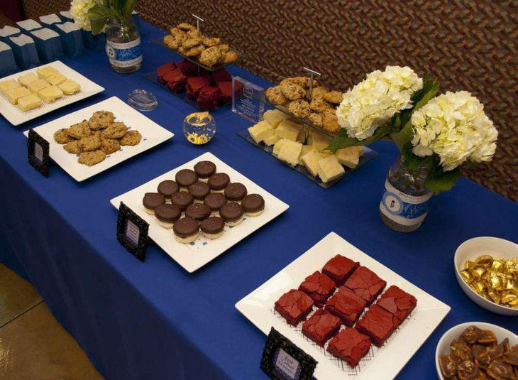 Blue accented retirement dessert table