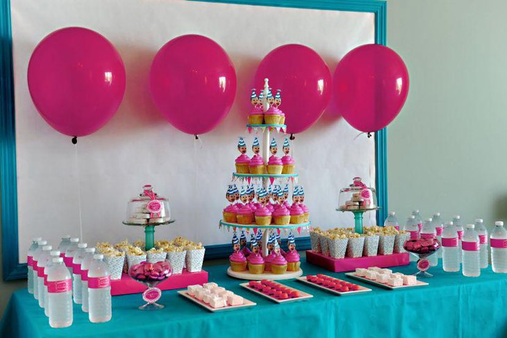 Blue and pink accented birthday party dessert table decor