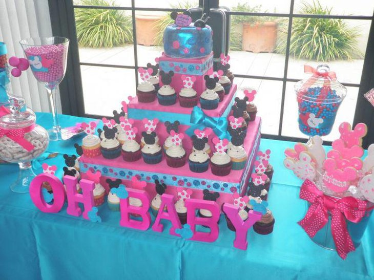 Blue and pink twin baby shower table decked up with Mickey and Minnie Mouse theme
