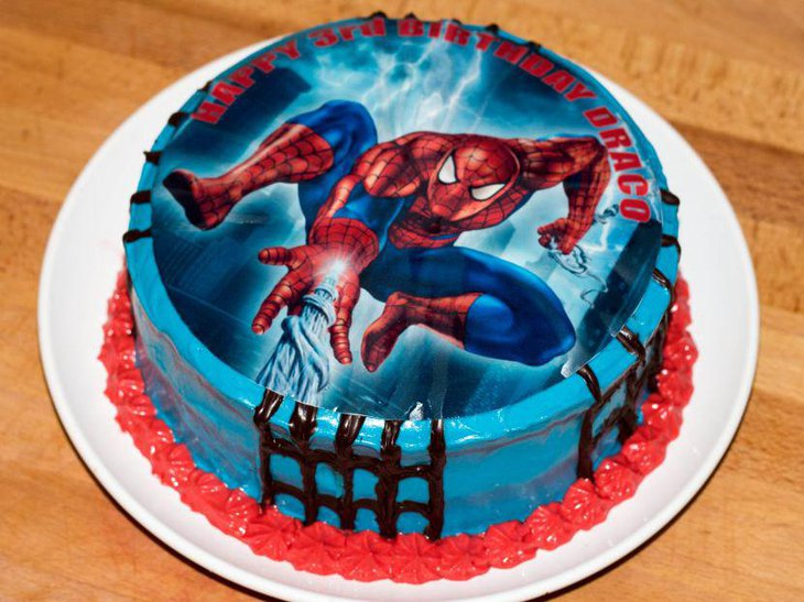 Blue birthday cake with spiderman image