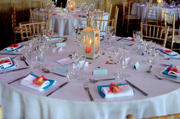 Blue red and orange decor on wedding breakfast table