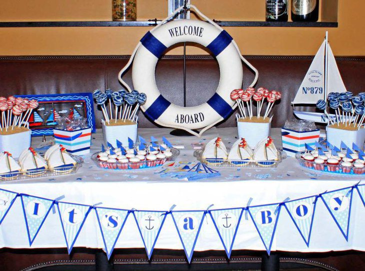 Boy baby shower table decor with tube and boats
