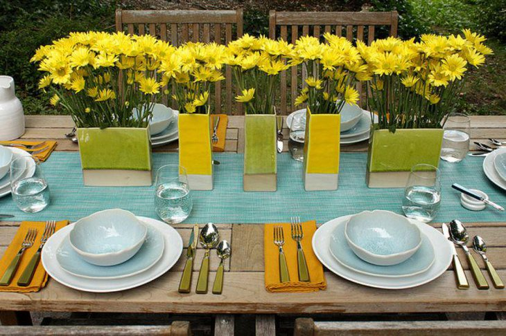 Breezy garden party table decor with blue green and yellow accents