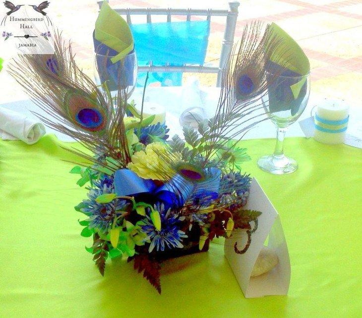 Bright peacock centerpiece with flowers