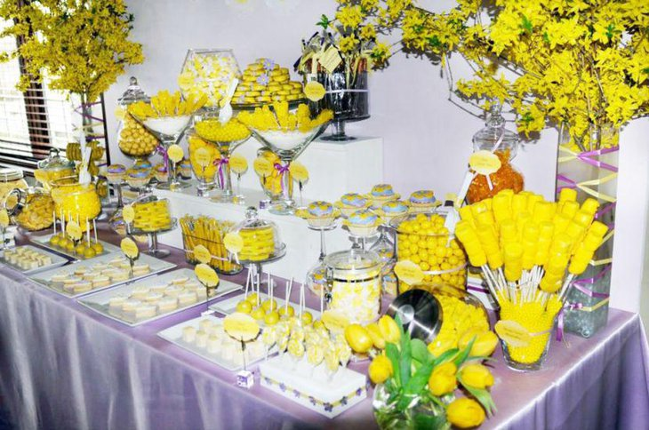 Bright yellow candy spread on baby shower candy table