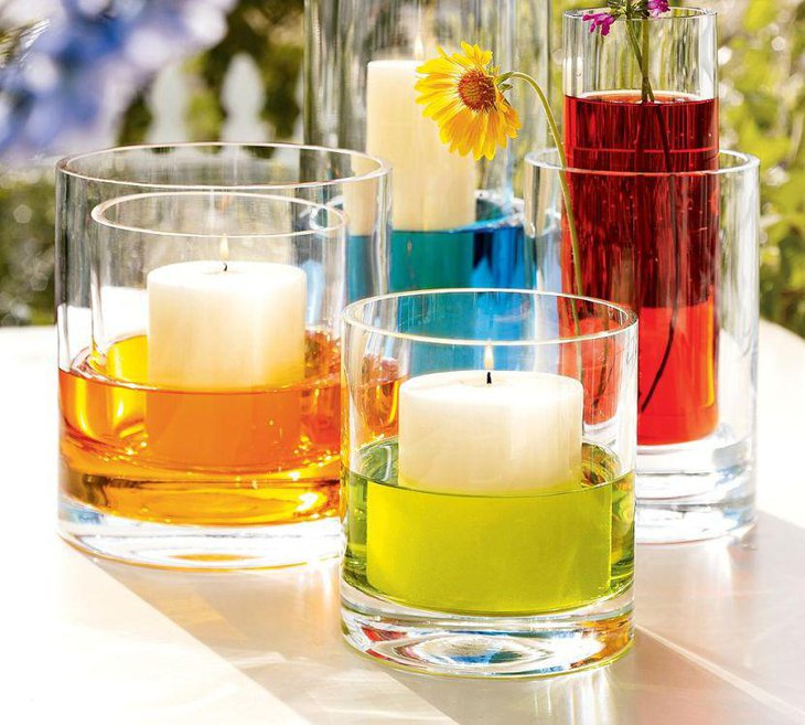 Candles in colored water for centerpiece for summer garden party