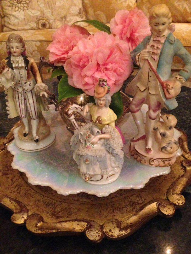 Ceramic figurines on tray Valentines centerpiece