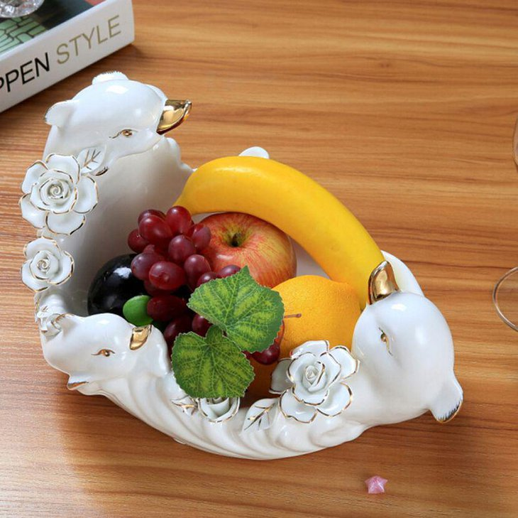 Ceramic fruit bowl centerpiece decor on modern coffee table