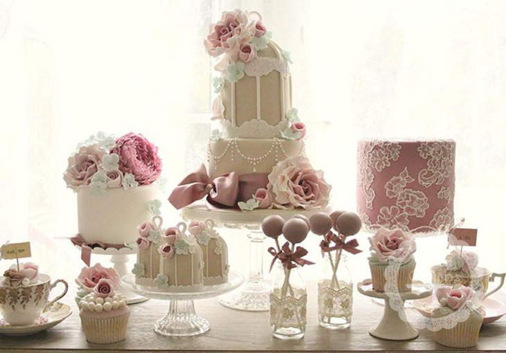 Charming European pink and white themed dessert table