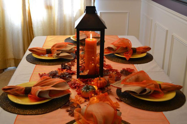 Charming Table Centerpiece Design Including Moroccan Lanterns With Orange Candle Plus Small Pumpkin