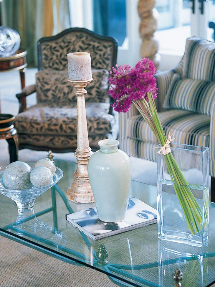 Chic contemporary coffee table setting with candlestick and flowers