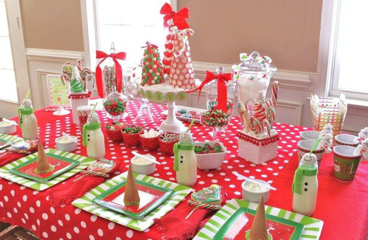 Christmas dessert table decor with candy cones and bottles