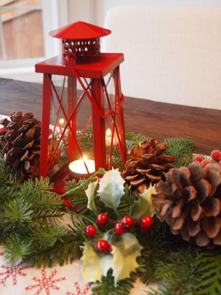 Christmas Table Centerpiece Idea With Red Lantern With Candle and Pinecones