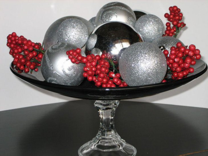Christmas Table Centerpiece With Black Bowl Filled With Cranberries and Silver Balls