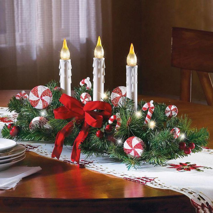 Christmas Table Decor With Ornamental Candles Bow and Ornaments