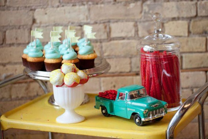 Classy wedding dessert table decor with vintage car with candies