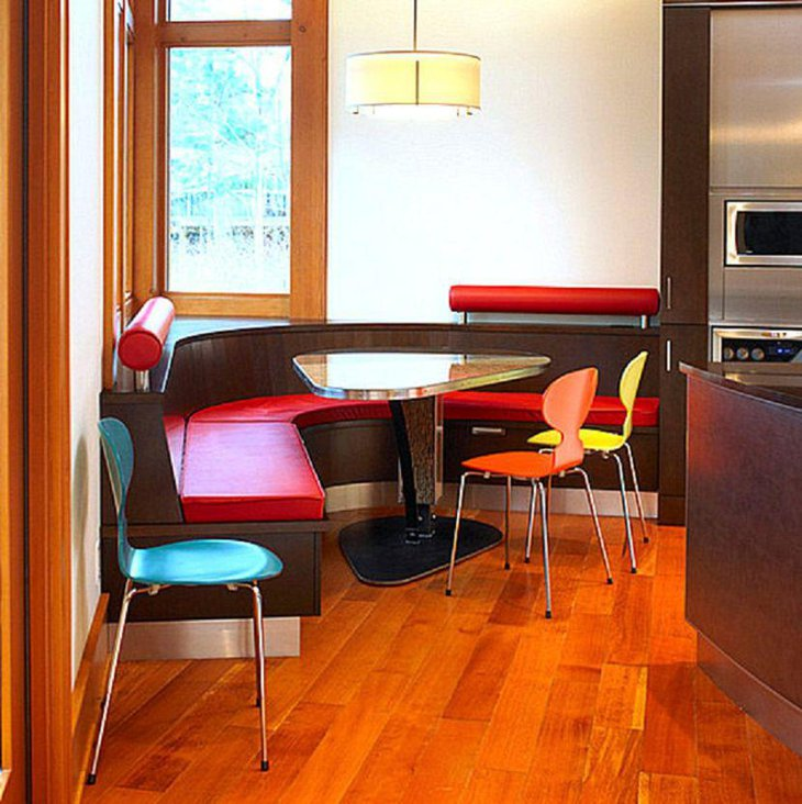 Colorful curvy breakfast nook with small glass table