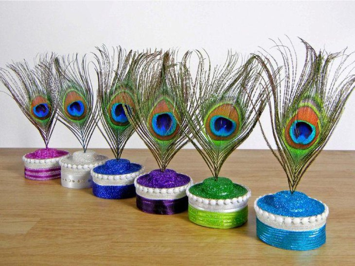 Colourful bridal shower peacock feather centerpieces