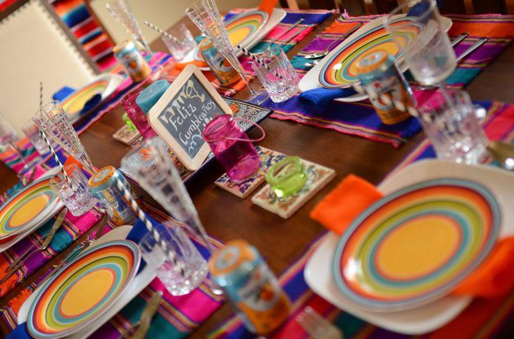 Colourful Mexican themed birthday party table setting