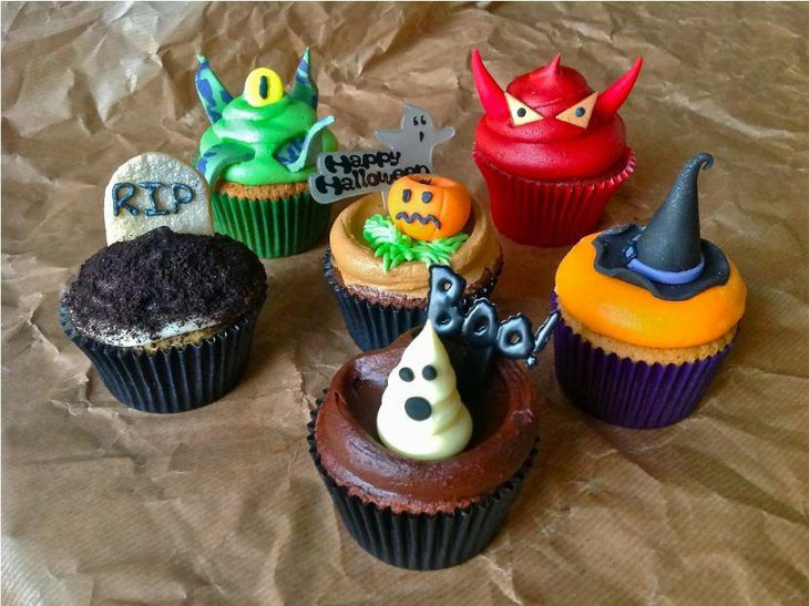 Colourful monster cupcake decorations on kids Halloween table