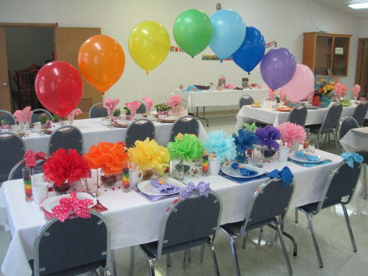 Colourful retirement table decor with ruffled floral centerpieces