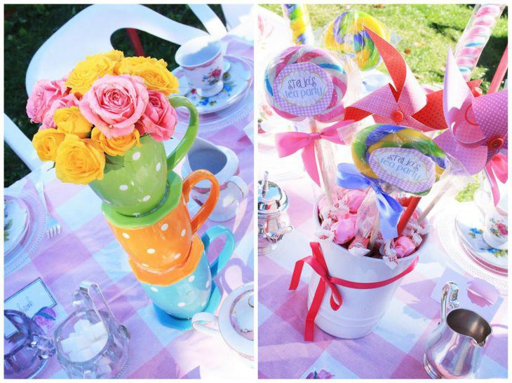 Colourful tea party tea cup centerpiece with flowers and bucket filled with lollipops