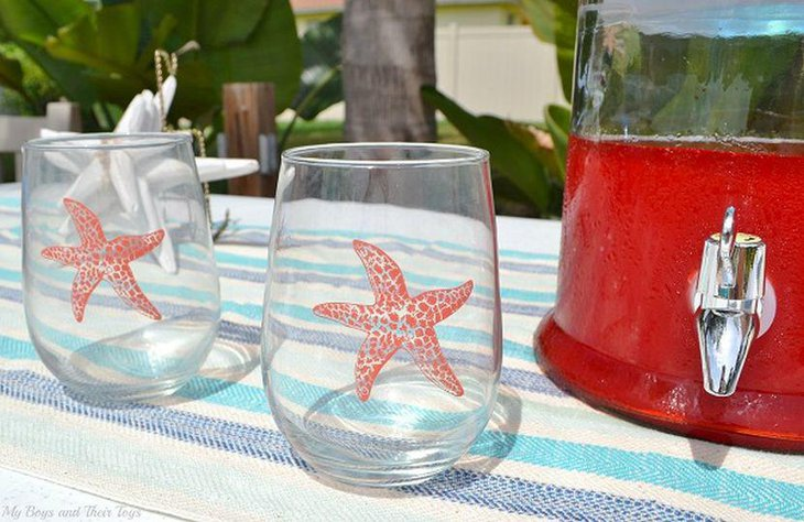 Cool beachy inspired garden party table decor with glasses embossed with starfish