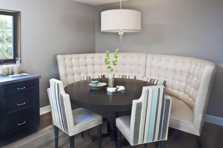 Cool Breakfast Nook With Curved Banquette Bench And Round Table