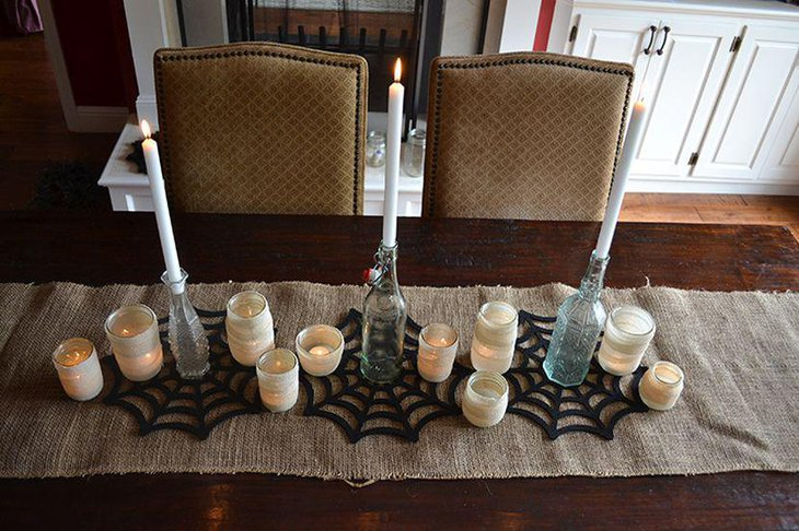 Cool DIY glass and candle centerpiece for Halloween table