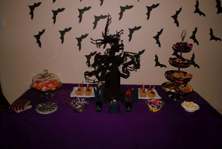 Cool Halloween dessert tabletop decor with black tree centerpiece and treats