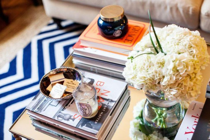 Cool piled up books on coffee table