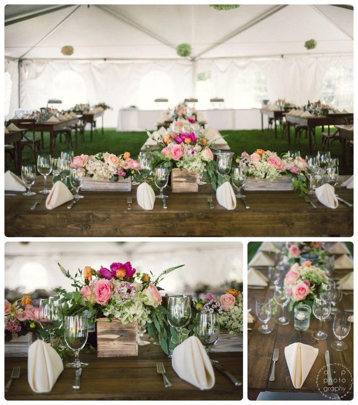 Country wedding reception tables decked up with wooden box centerpieces