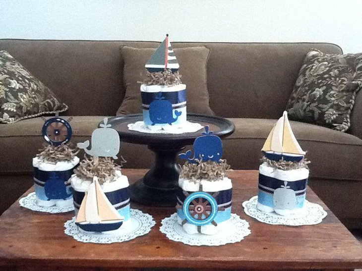 Crafty nautical diaper cake centerpiece decor on table