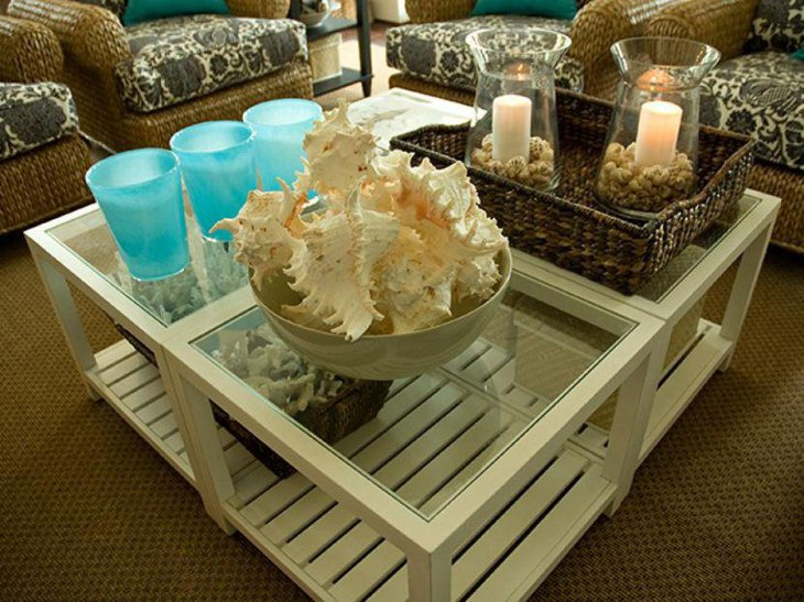 Creative coastal inspired coffee table decor with rattan basket and conches