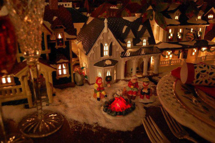 Creative lit up house decoration on christmas table