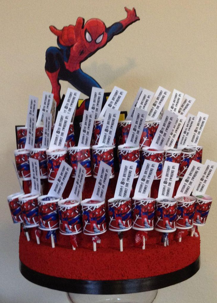 Creative Spiderman birthday party table centerpiece with candies and Spiderman cutout