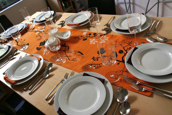 Creatively printed orange colored table runner for Thanksgiving